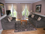 Living room features a view of the gardens, watch horse drawn carriages ride by!