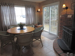 Dining room with wood burning fireplace