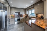 Kitchen - Stainless steel appliances and quartz counter tops